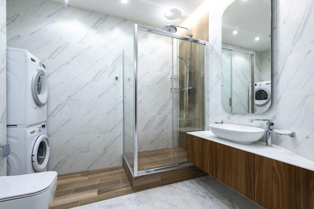 Interior of modern bathroom with shower cabin