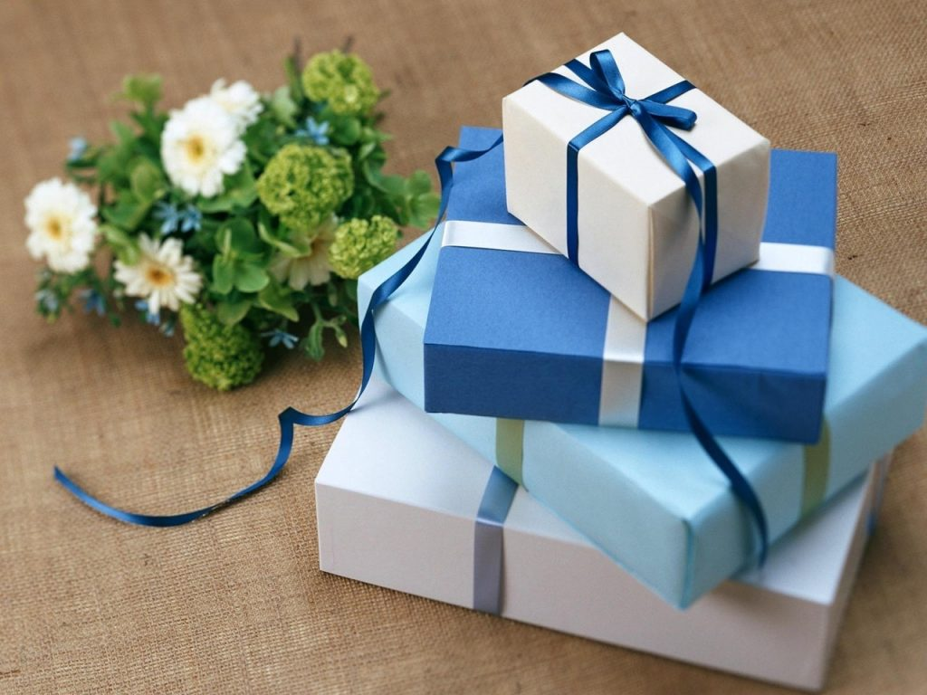 Several Gift Boxes Near the White Flowers